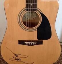 Receive a Fender Acoustic Guitar Signed by Luke Bryan
