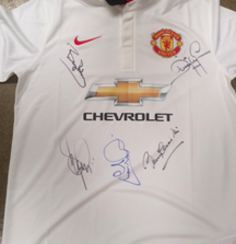 Manchester United Jersey Signed by Dwight Yorke, Bryan Robson, Sir Bobby Charlton, Andrew Cole, and Denis Irwin
