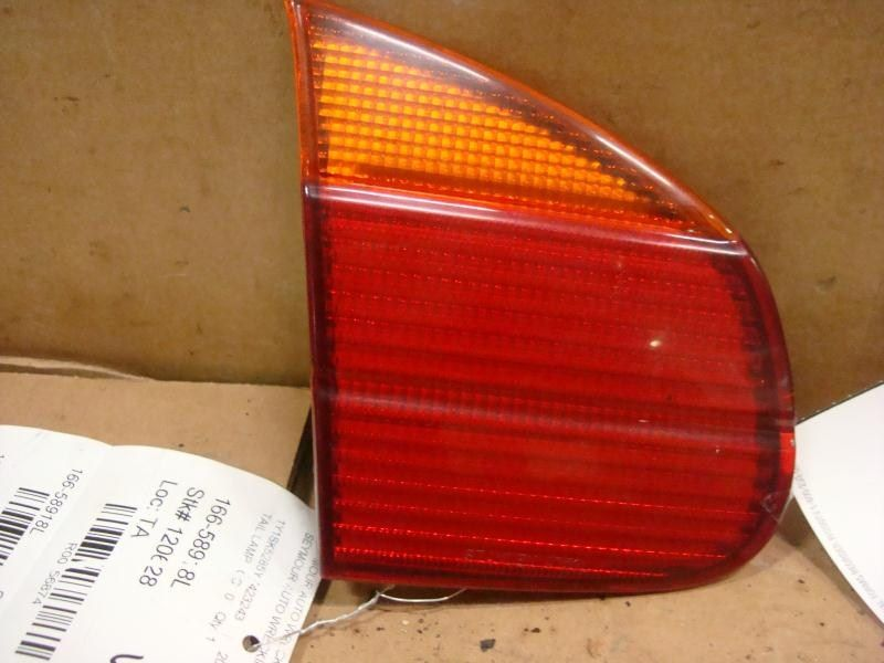 98 99 00 01 02 PRIZM LEFT TAIL LIGHT LID MOUNTED