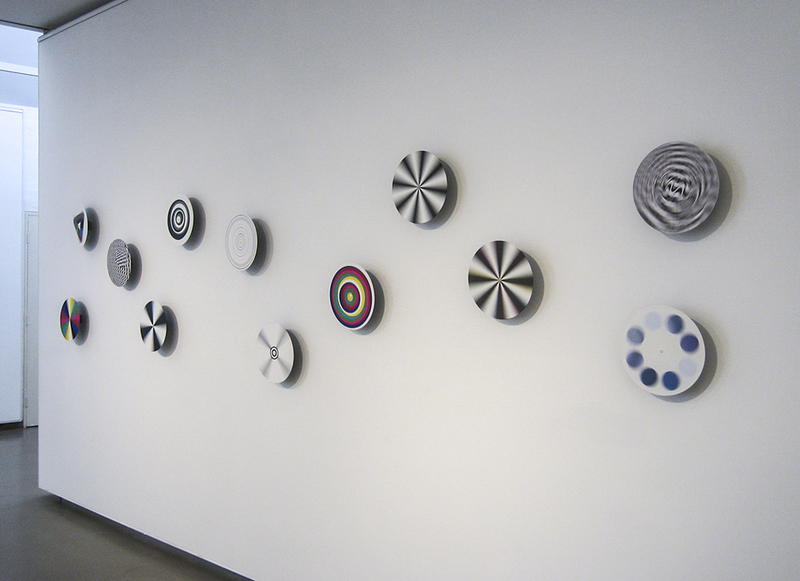 LUKE PARKER Test pattern tests, 2006 acrylic on vinyl records, electric motors, dimensions variable