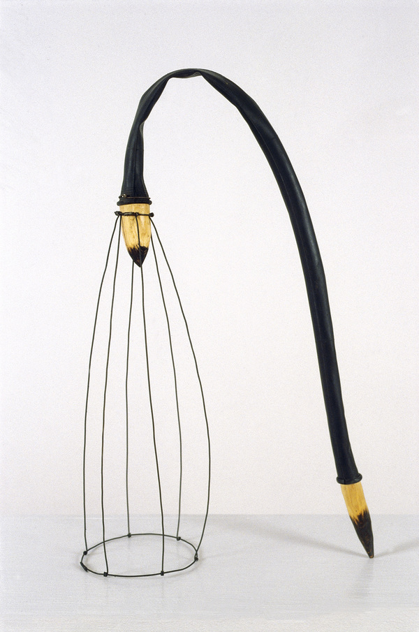 Pam J. Brown Sculpture 14 ga. steel wire, 24 ga. steel wire, wood, rubber bicycle inner tube.