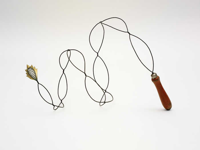 Pam J. Brown Sculpture 14 ga. steel wire, brass foil, seeds, wooden handle.