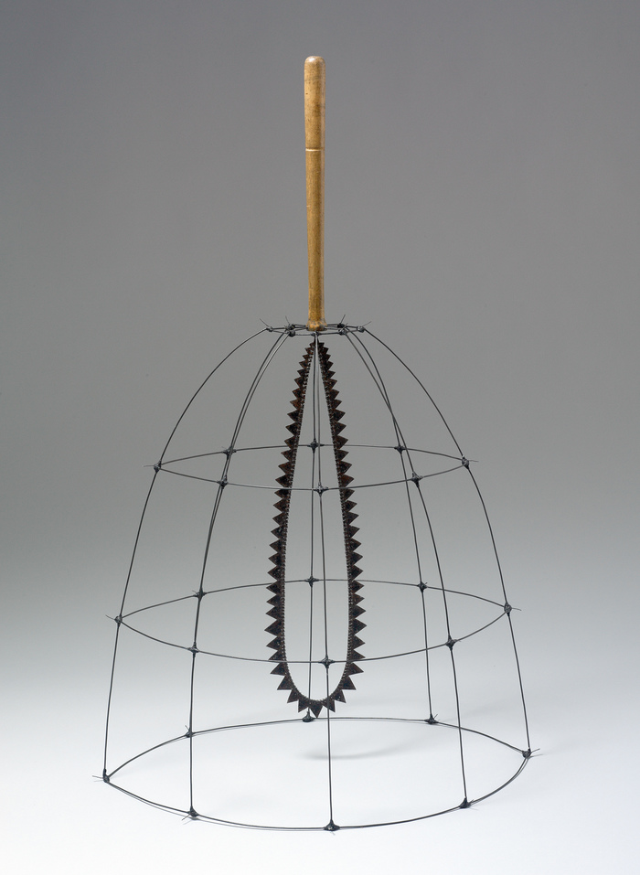 "Pam J. Brown Sculpture 1/16"" sheet metal, 14 ga. steel wire, fabric tape, antique wooden handle."