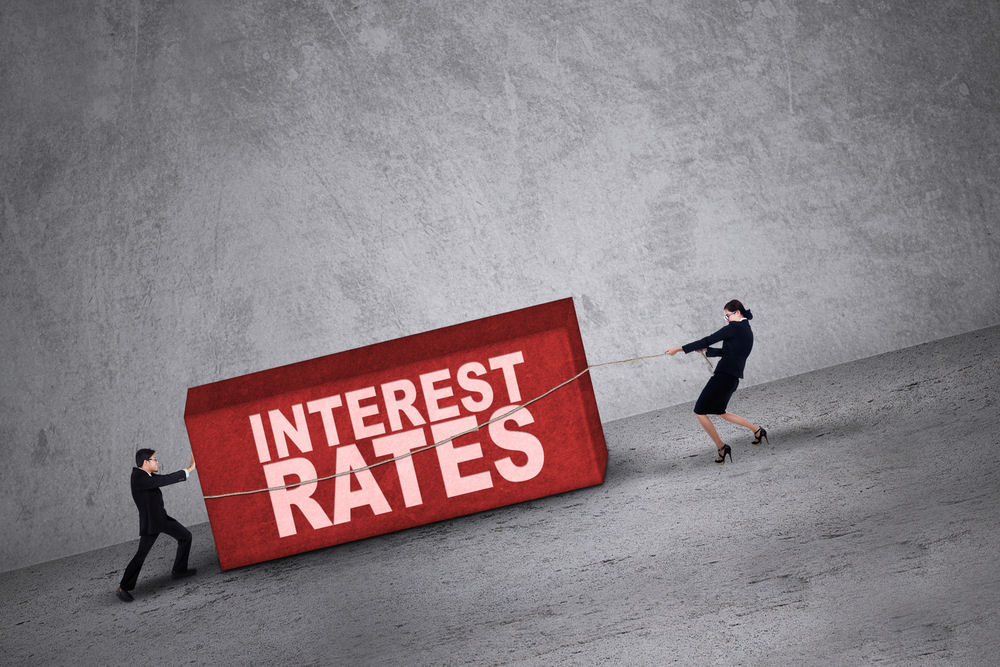 Stocks mixed, interest rates rise
