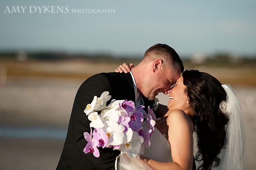Hug At Beach With Flowers
