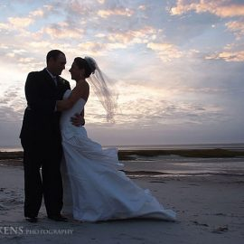 bride-and-groom-at-sunset-on-beach.jpg#asset:32:thumb