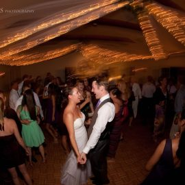 Bride And Groom Dancing Under Lights