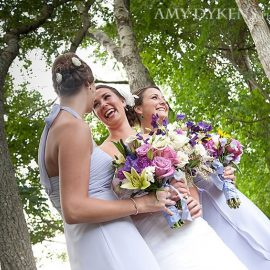 bride-smiling-with-flowers.jpg#asset:47:thumb