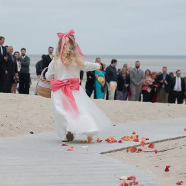 Flower Girl Throwing Petals On Beach Walk