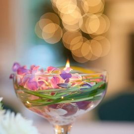 Flowers In Water And Candle
