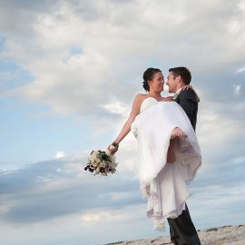 groom-holding-bride-at-beach.jpg#asset:67:thumb