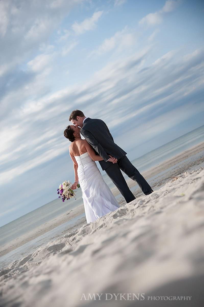 Bride And Groom Kissing At An Angle