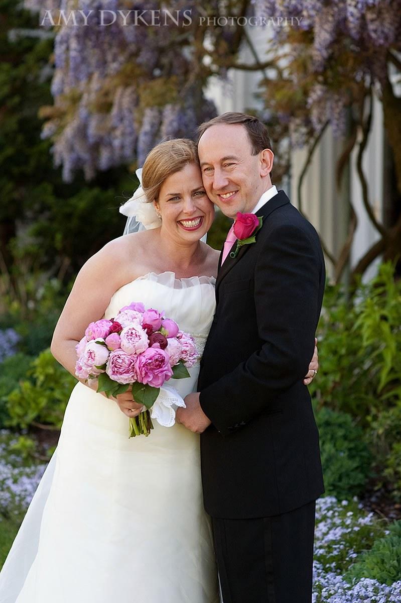 Bride And Groom Under Wisteria