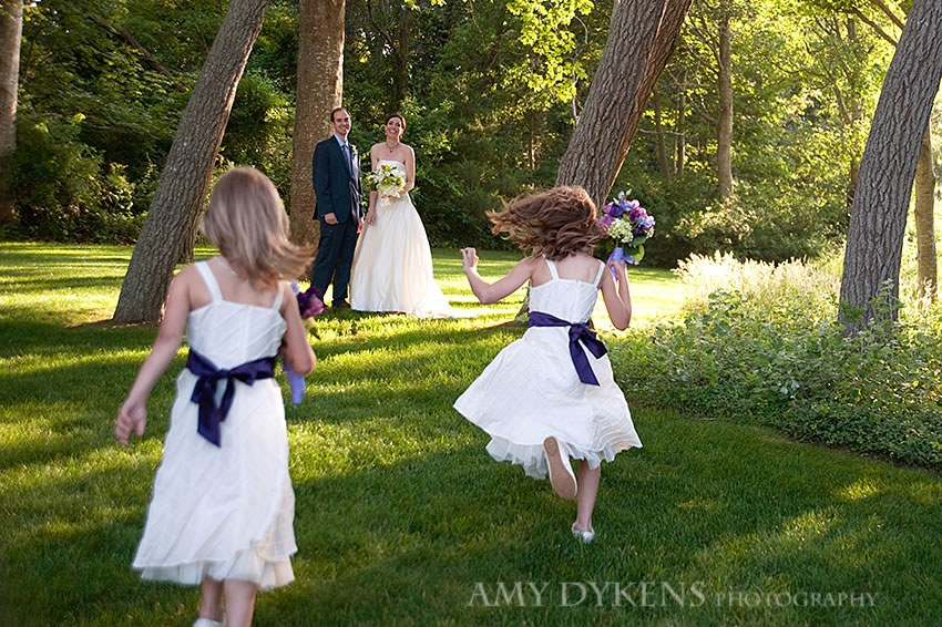 Bride And Groom With Kids On Grass