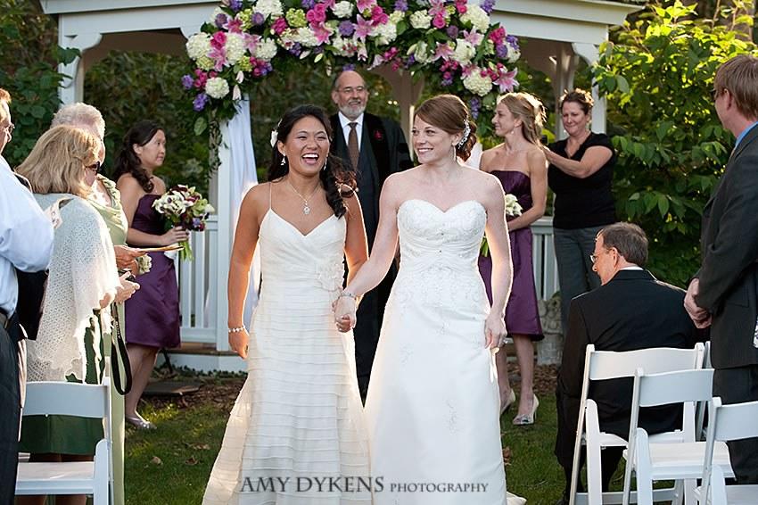 Brides Smiling By Gazebo