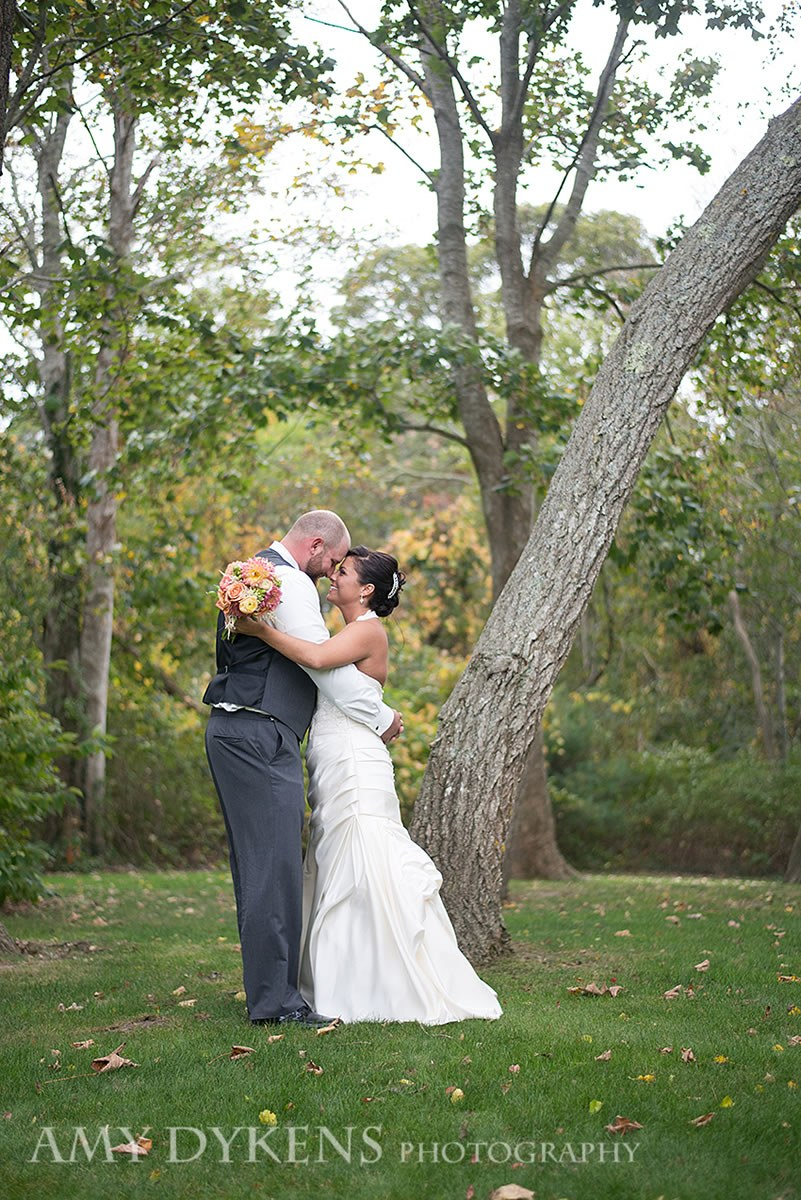 Couple Hugging By Tree