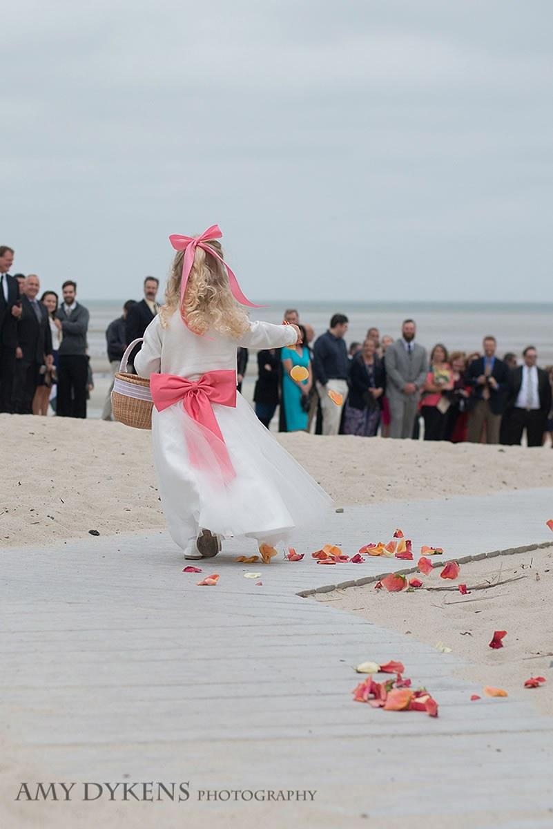 Flower Girl Throwing Petals On Beach Walk
