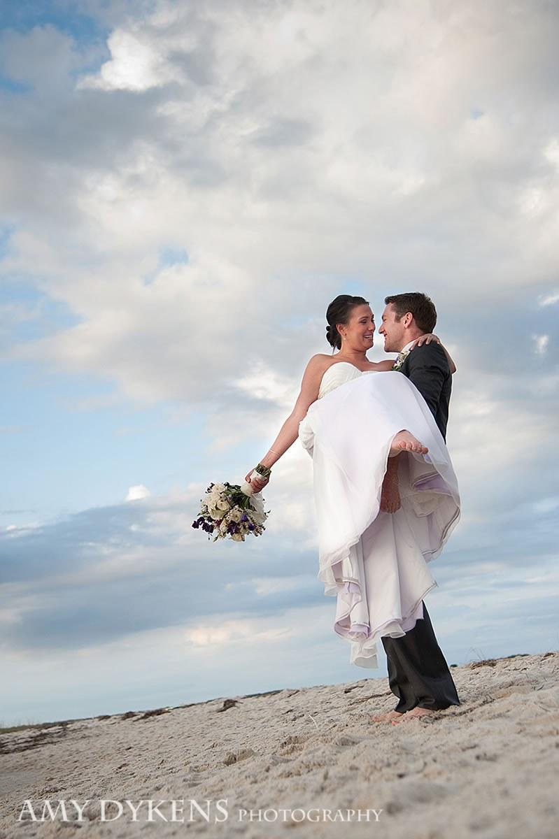 Groom Holding Bride At Beach