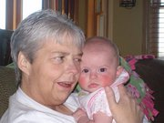 Lisa Krejcarek, Coleman, holds her granddaughter