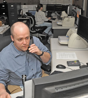 A Marinette County 911 Dispatch Worker fields a call (Photo by EHExtra.com)