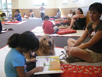 Paws to Read is a program sponsored by the Livermore Public Library and the Valley Humane Society Photo Credit: Livermore Public Library