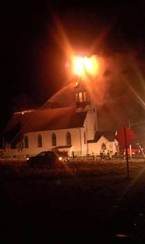 The Klondike Community Church suffers major damage from a fire March 19. (Photo by Tristen Holtger)