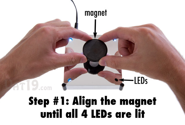 To use the Levitron Revolution, start by aligning the magnet in the center of the base.