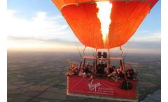 Virgin Champagne Balloon Flight - Over 100 UK Locations! £99 for an Anytime Plus hot air balloon experience with Champagne for one person, £189 for two - choose from over 100 UK locations and save up to 50% - wowcher