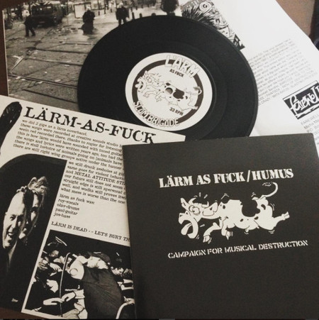 "Lärm As Fuck / Humus – Campaign For Musical Destruction Split 7""EP"