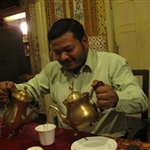 Suresh having tea and coffee - together