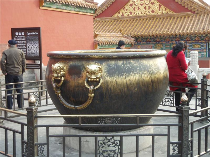 urn, usedr for fire extinguisher, gold scraped off by European invaders during the crushing of the Boxer rebellion.