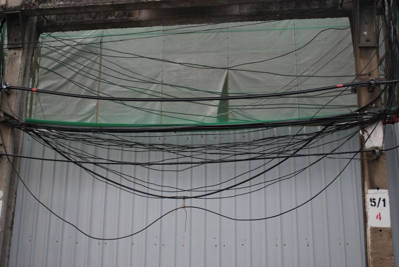 I wonder how electricians know which wire to fix? Frequent sight in Thailand...