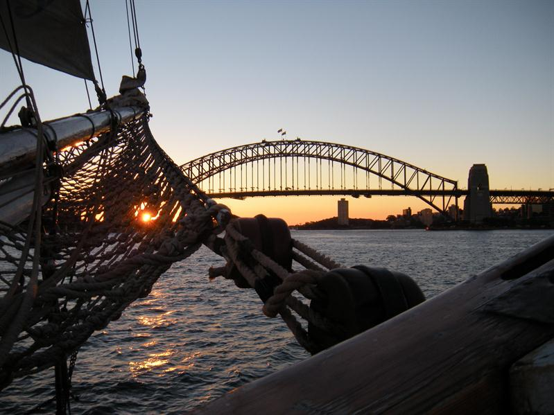 Sunset under the harbour bridge from the Southern Swan