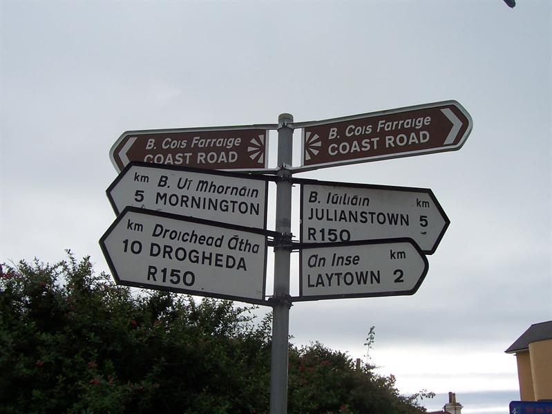 This is how all signs are in Ireland. Much less confusing if you know exactly where you want to go.