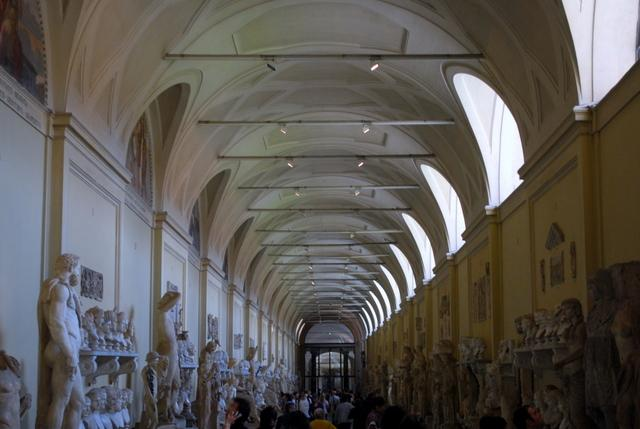 A long hall full of busts and statues