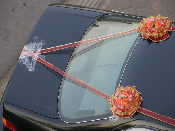 Decorated wedding car - all I kept thinking was how angry Dad would be to see sticky tape plastered all over the back of his car...