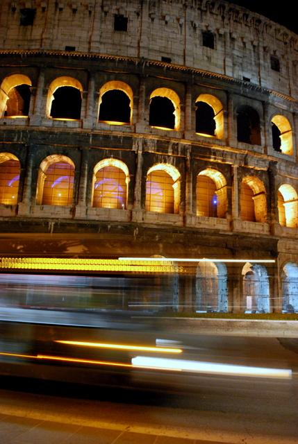 Bus goes by the Colosseum