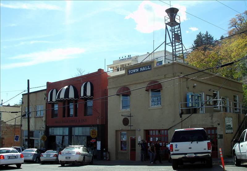 With the police station and the old fire statioin in the Town Hall. Next to it is the Mile High Grill and Inn, built in 1899.