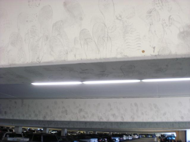 Caesar's parking garage. Every beam was like this: covered in footprints.  How odd...