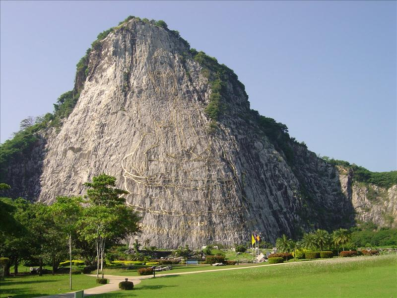 Golden Buddha image was carved on the hill