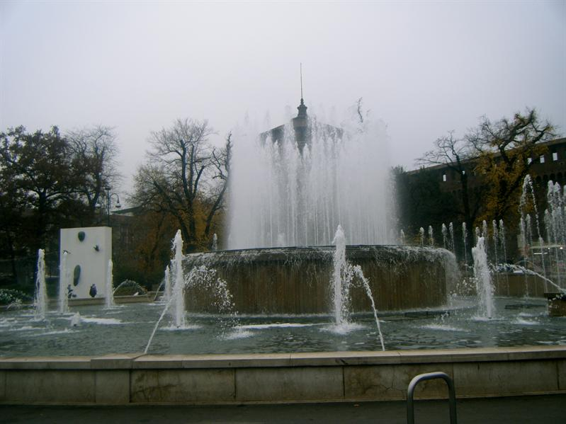 a fountain in front of the castle