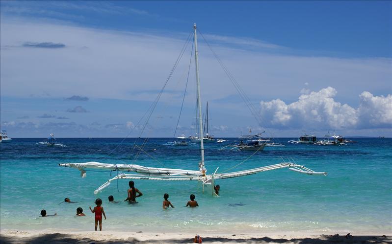Beach Scene Banca Boat Swimmers