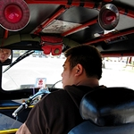 In a tuk-tuk on the way to Wat Rampoeng temple for a Vipassana retreat.