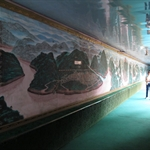 The mural wall shows the old cities or historic lands were all submerged under the the line of water level for the three gorges dam project.