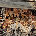 Doll stall on busy street of Hanoi