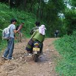 Locals passing on their bikes to get to their villages