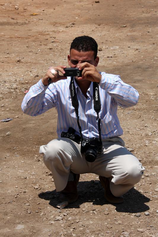 De chauffeur-fotograaf