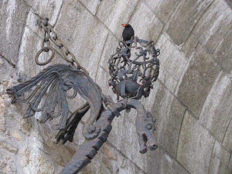 A dragon guarding the prison.