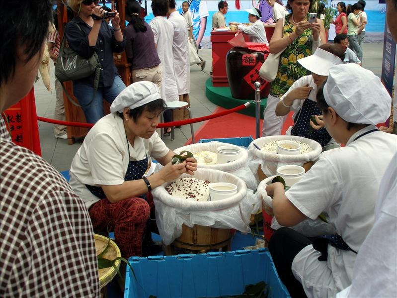 Local workers making Zongzis (aka Chinese Tamales) for the Dragon Boat Festival.