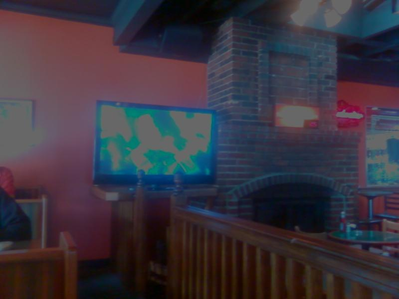 a big flatscreen TV at the main bar